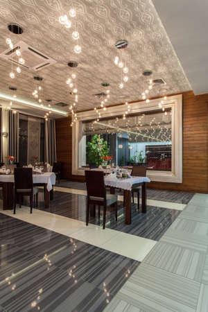 Woodland hotel - Restaurant dining room interior, table set Stock Photo - 17495263