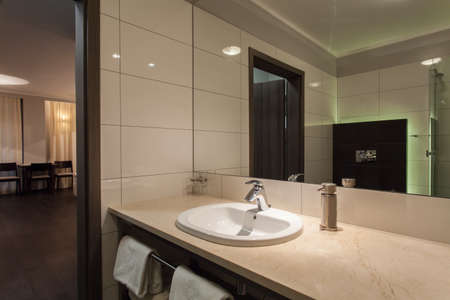 Woodland hotel - Ceramic washbasin in modern bathroom photo