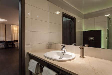 washbasin: Woodland hotel - Ceramic washbasin in modern bathroom Stock Photo