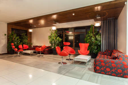 Woodland hotel - Hotel hall with red decorations Stock Photo
