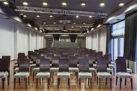 conference centre: Woodland hotel - Conference hall with neatly arranged seats