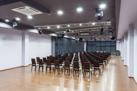 conference halls: Woodland hotel - Spacious conference room with chairs Stock Photo