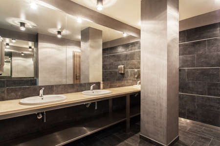 lavatory: Woodland hotel - Interior of modern and grey bathroom