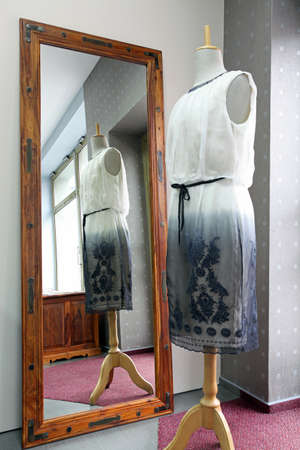 tailor shop: Unfinished dress on mannequin in a tailor shop Stock Photo