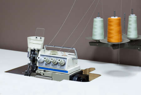 Overlock with colorful spools in a tailor shop photo