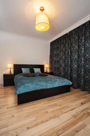 Modern interior- turquoise bed in a new bedroom Stock Photo - 17669384