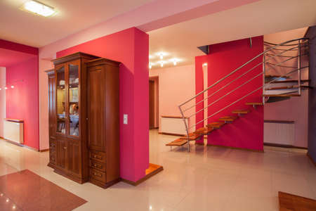 commode: Amaranth house - Colorful interior, bright pink walls Stock Photo