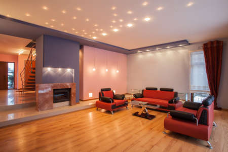 Amaranth house - Living room with a red sofa Stock Photo - 17700713