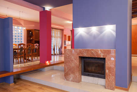 Amaranth house - Marble fireplace in colorful living room Stock Photo - 17700714