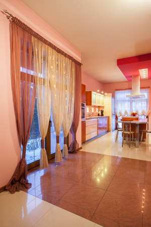 Amaranth house - Kitchen with an original curtains Stock Photo - 17700763
