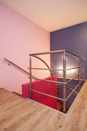Amaranth house - Stairs with a metal banister and pink wall Stock Photo - 17700760