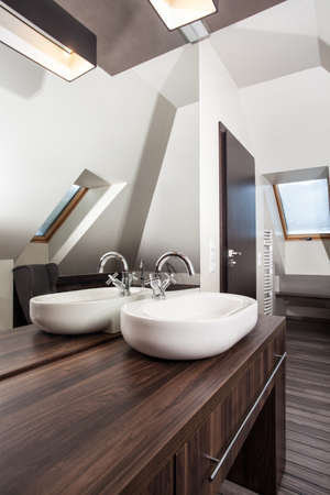 Country home - ceramic vessel sink in modern bathroom photo