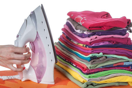 Arranged clothes,  iron, hand on isolated background photo