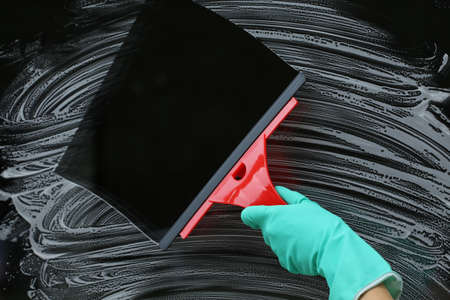 squeegee: Cleaning the window with squeegee for glass