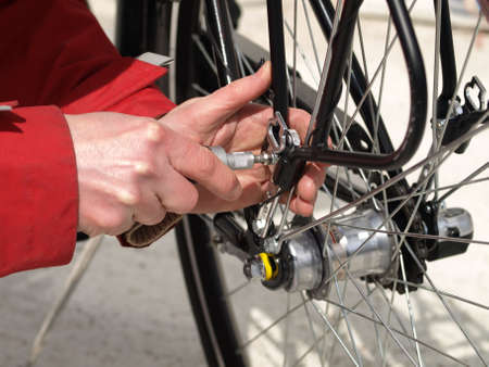 serviceman: Serviceman repairing a bicycle tire with tools