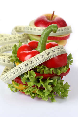 Sliced vegetables with lettuce with measure, isolated photo