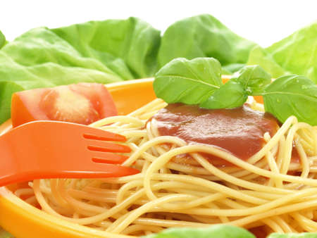 Portion of pasta with tomato sauce in lettuce Stock Photo - 17923524