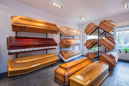 Wooden brown coffins in a funeral home photo