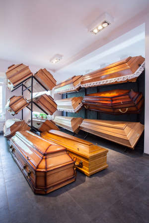 cremation: Wooden brown different coffins in funeral home