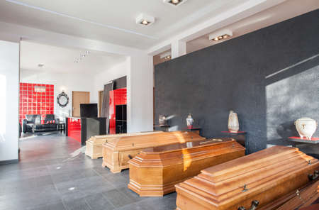 coffins: Coffins and urns in a funeral office