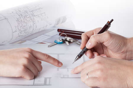 Architect with a client showing projects of a house photo