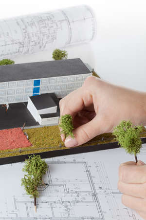 Architects hand making model of a building photo