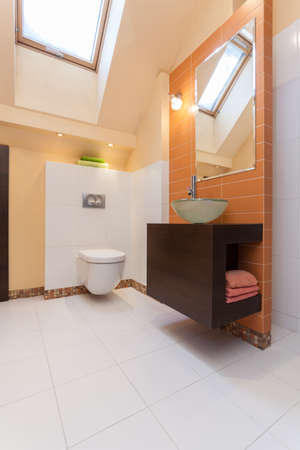 Classy house - interior of modern orange bathroom photo