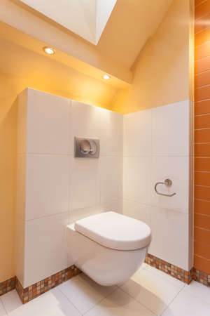 classy house: Classy house - White and orange toilet room