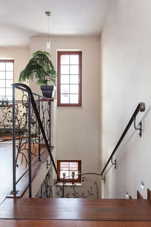 classy house: Classy house - stairs with original metal banister Stock Photo