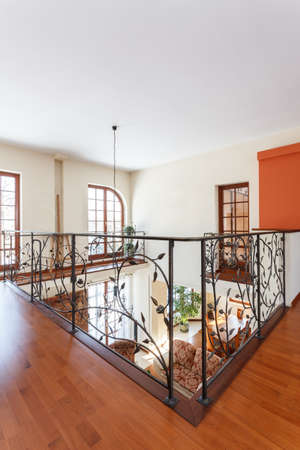 classy house: Classy house - Elegant mezzanine with metal patterned banister