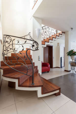 classy house: Classy house - metal design stairs leading to living room Stock Photo