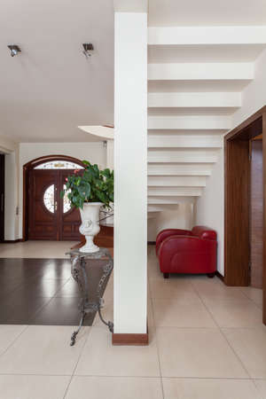Classy house - stairs, armchair and a pillar Stock Photo - 18178541