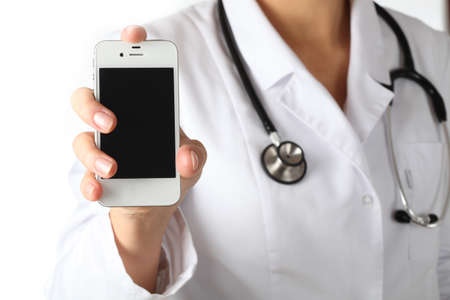 emergency call: Doctors hand showing phone to get in touch Stock Photo