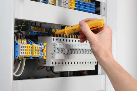 electrical appliance: Voltage control in switchboard with special detector Stock Photo