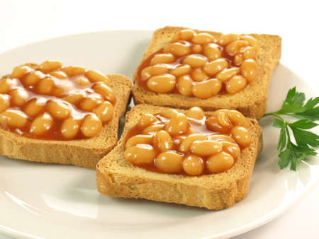 baked beans: Beans on toast on plate on isolated background Stock Photo