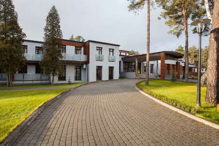 Woodland hotel - Cobbled road for modern hotel photo