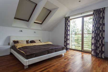 Elegant and modern bedroom with a balcony photo