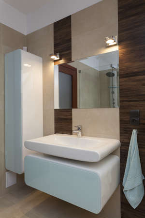Elegant and contemporary washbasin in a bathroom photo