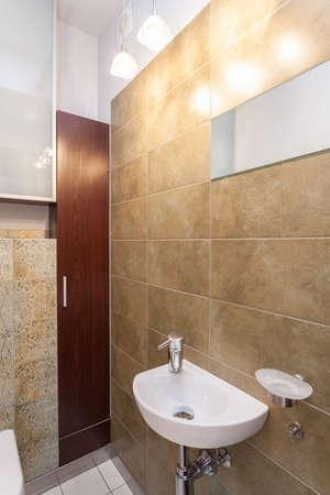 Spacious apartment - Wash basin in a small bathroom Stock Photo - 18439758