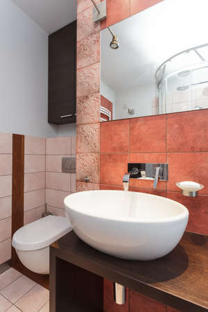 bathroom interior: Spacious apartment - Modern wash basin in new bathroom interior