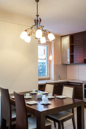 Spacious apartment - Modern kitchen with wooden table Stock Photo - 18439766