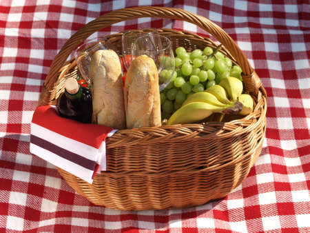 picnic blanket: Blanket and picnic wicker filled with food