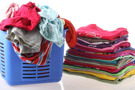 Laundry in basket and ironed clothes, isolated photo