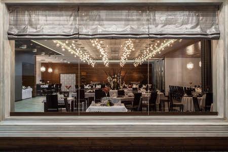fine silver: Woodland hotel - restaurant view through a huge window Stock Photo