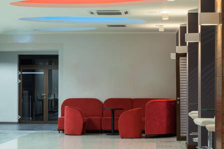 seating: Woodland hotel - red couch and armchair in reception