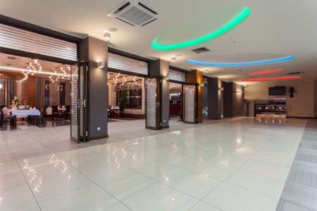 hotels building: Woodland hotel - main hall and luxurious restaurant Stock Photo