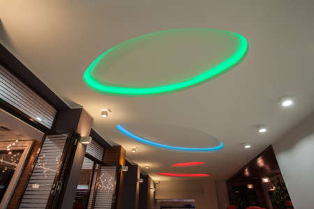 light columns: Woodland hotel - colorful neon lights on hall ceiling