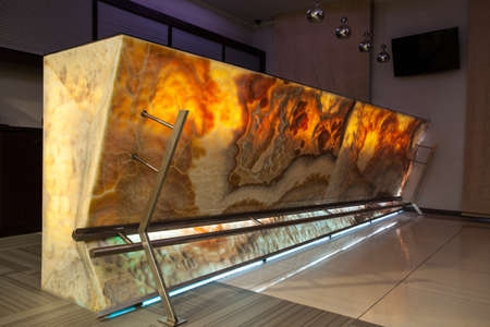 countertop: Woodland hotel - interior of a contemporary bar with onyx countertop