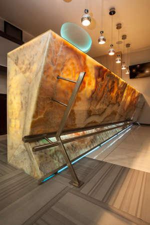 onyx: Woodland hotel - closeup of an onyx stone bar counter