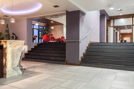 woodland hotel: Woodland hotel - wide stairs, entrance and bar